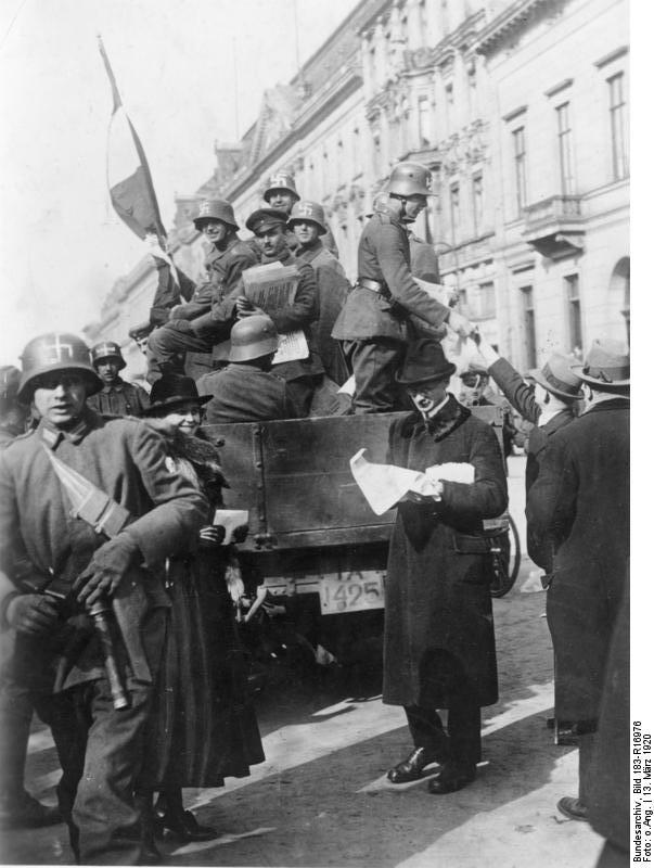 Member of Freikorps Ehrhardt wearing WWI era helmets with hastily applied swastika