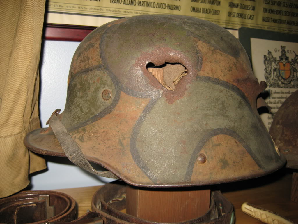 This helmet purports to be a vet capture from Château-Thierry, and is marked as such with medical tape. The catastrophic nature of the shrapnel damage  and several bullet holes does give credence to this helmet being a true combat veteran