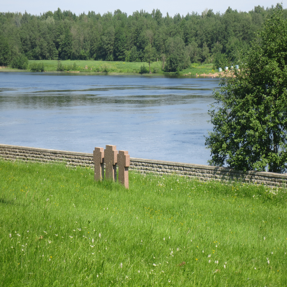 Three German graves look accross the Narva river into Russia