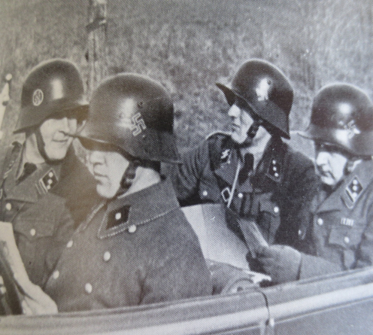 Men from the SS-Verfügungstruppe out for a drive. The men here wear Austrian M17 helmets with hand rendered insignia
