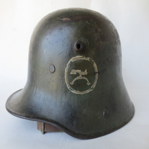 Original M16 helmet with hand rendered MG insignia.  This helmet was procured from an American WWI veteran's estate in the 1960s