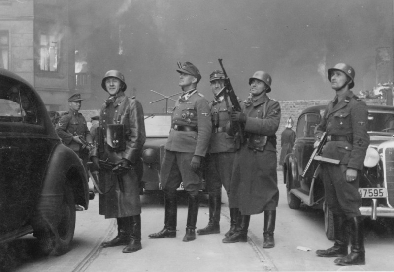 Photo taken during the Warsaw Ghetto uprising of 1944. These members of the SS are still wearing the party shield decals. Note the smooth parade finish