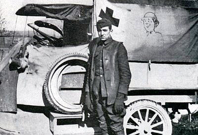 The young Walt Disney standing in front of the ambulance  he drove on the post-war battlefields of the Great War.