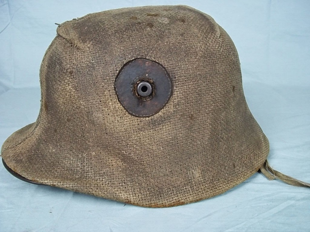 Crudely made Hessian cloth cover on a M16 helmet