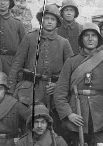 German soldiers wearing improvised cloth covers on their helmets