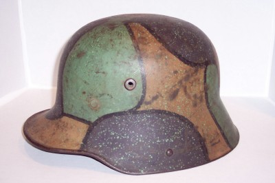 This unusual choice of colors may be an example of a early post-war helmet.