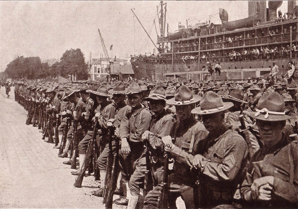 American Soldiers Arrive in France on June 25, 1917. These men all wear wool felt hat more suitable for the American frontier then the trenches of France. These men would all soon be wearing steel helmets