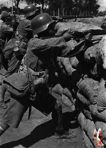 A member of the 88th division mans the barricade during the battle of Shanghai