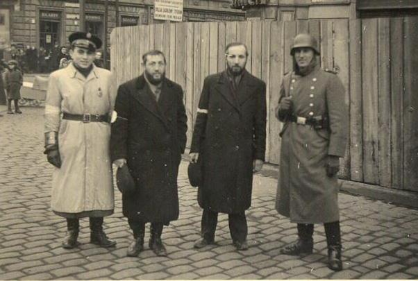 Nothing to smile about. Two residence of the Krakow Ghetto along side a member of the Ghetto Police and