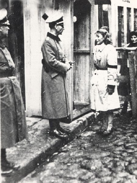Papers please. A Jewish women is questioned.