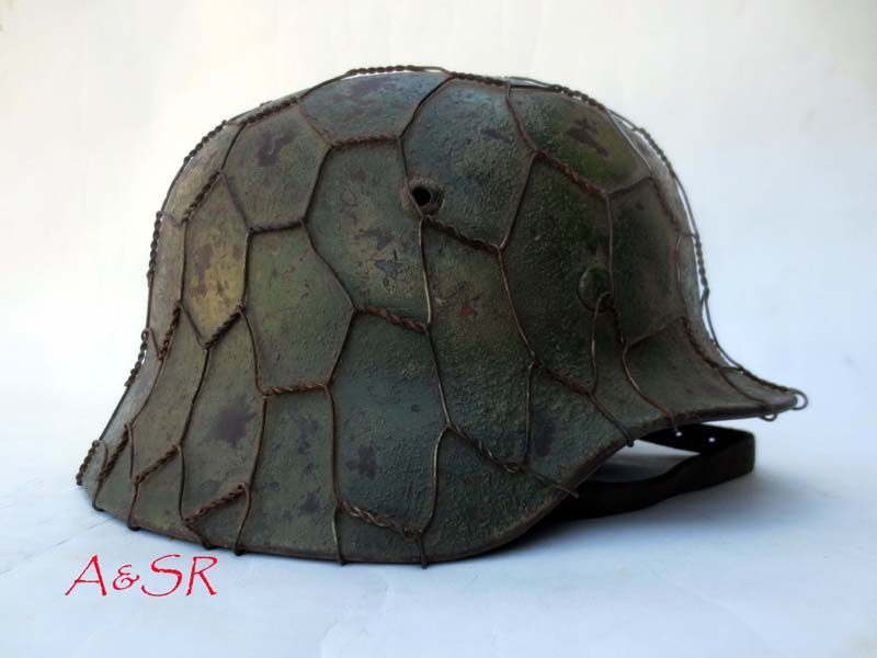 M35 Heer Two color Italian front camo with full chickenwire basket.