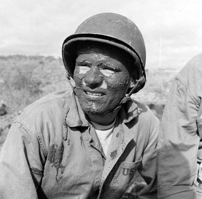 Photo of a Marine during training in Southern California before shipping to the South Pacific. He wears a short chinstrap on his M1.