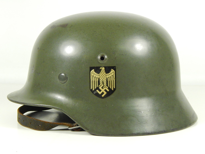 74359c7409a German Heer M35 helmet. Note the semi gloss finish