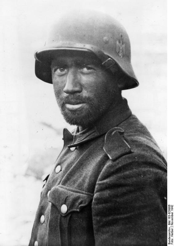German soldier wearing a M40 helmet. This photo was taken in November of 1942. The battle had ready turned against the Germans, but months of fighting still lay ahead for this man