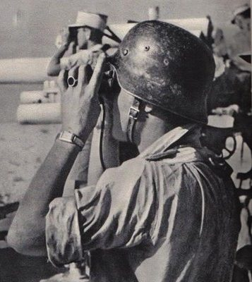 The brutal African sun would reak havic on helmet paint. The camoflaged paint on this helmet has almost worn away.